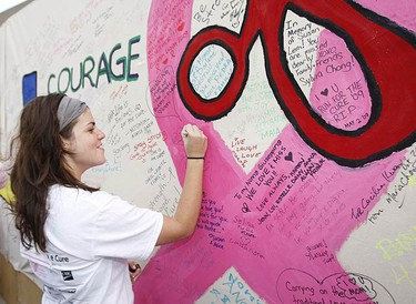 Breast cancer survivor Lori Markell giving her pooch Cali a big hug before the walk. (JACK BOLAND, Sun Media)