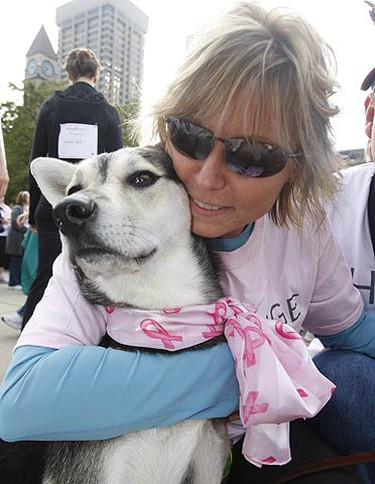 Breast cancer survivor Lori Markell gives her pooch Cali a big hug before the walk. (JACK BOLAND, Sun Media)