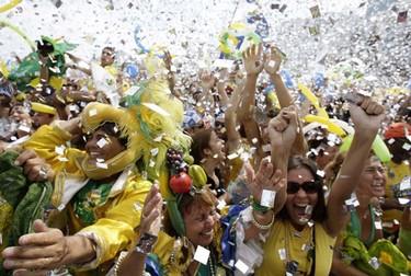 Residents celebrate after Rio de Janeiro won the bid to host the 2016 Summer Olympic Games, on Copacabana beach in Rio de Janeiro Oct. 2, 2009. (Sergio Moraes/REUTERS)