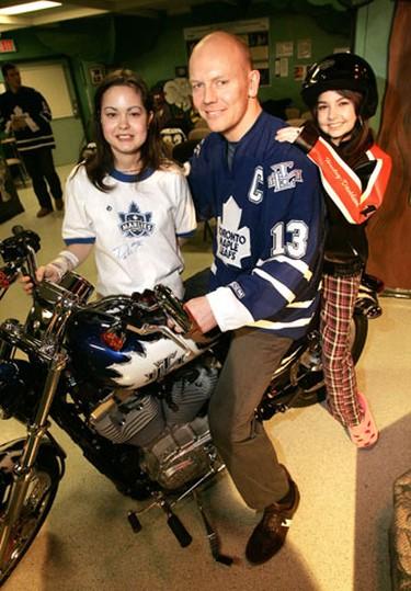 Sick Kids patients Candi Valadas and Alysse Charbon join Leaf captain Mats Sundin on a custom-built Harley-Davidson in 2007. (SUN MEDIA/Craig Robertson)