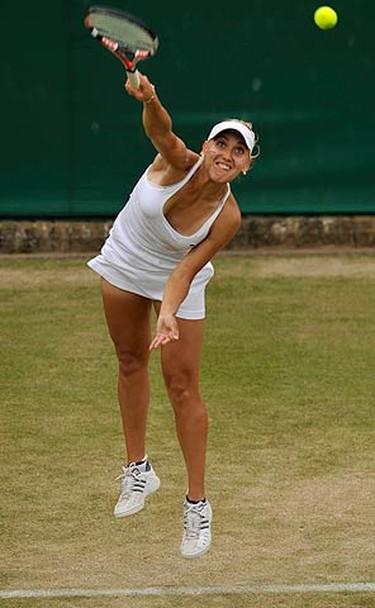 Elena Vesnina of Russia serves to Dominika Cibulkova of Slovakia during their match at the Wimbledon tennis championships, in London on June 26, 2009. (REUTERS)