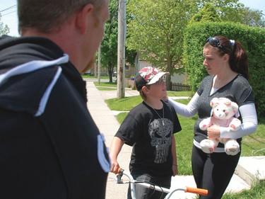 Victoria Stafford's mother Tara McDonald talks to her son Daryn and her ex-husband and Victoria's father Rodney Stafford.  (Elliot Ferguson/QMI Agency)