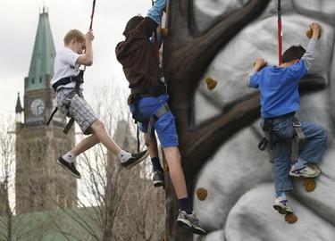Kids climb the rock wall at Majors Hill Park in Ottawa Sunday afternoon during the Tulip Festival. Tony Caldwell/Sun Media