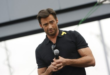 "Actor Hugh Jackman gestures as he attends the premiere of the movie ""X-Men Origins: Wolverine"" in Tempe, Arizona April 27, 2009. (Joshua Lott, Reuters)"
