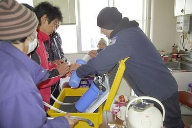Steve Kepka installs a purification system in earthquake-battered Japan. (GlobalMedic Photo)