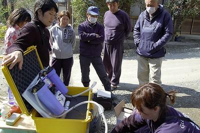 Peel EMS Supt. Shannon McNeil installs a Trekker water purification unit in earthquake-battered Japan. (GlobalMedic Photo)
