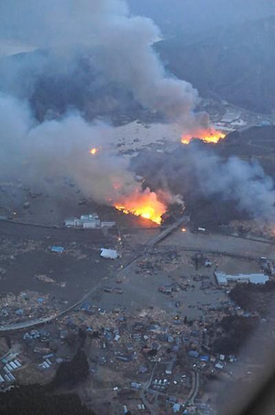Buildings burn following an earthquake in Otsichi town, Iwate Prefecture, northeastern Japan, March 11, 2011. REUTERS/YOMIURI