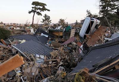 Destroyed homes and vehicles litter the landscape in Higashi-Matsushima, Miyagi Prefecture March 23, 2011 following the magnitude 9.0 earthquake and tsunami.  REUTERS/Yuriko Nakao