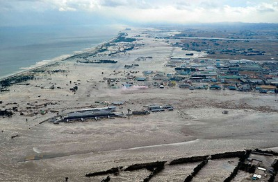 Sendai Airport is flooded after a tsunami following an earthquake in Sendai, northeastern Japan, March 11, 2011. REUTERS/Kyodo