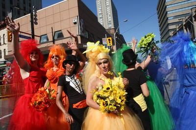 Revelers attend the 2010 Pride parade in downtown Toronto. (STAN BEHAL/QMI Agency/Toronto Sun)