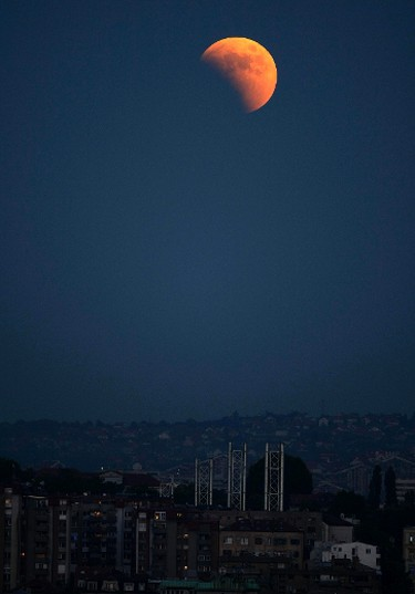 A partial lunar eclipse is seen over the skies of Belgrade on June 15, 2011. (REUTERS/Marko Djurica)