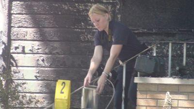Winnipeg fire investigators at scene of fatal house fire in Point Douglas area on Sat. July 16, 2011. Examining area of front porch, amid homicide probe following four deaths in the blaze. Ross Romaniuk/Winnipeg Sun.