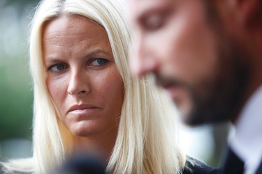 Norway's Crown Princess Mette-Marit and Crown Prince Haakon speak to the media after visiting youths injured in the Utoeya island shooting massacre at Ringerike hospital in Sundvolden July 24, 2011. (REUTERS/Trond Reidar Teigen/Scanpix)