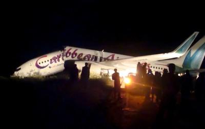 Caribbean Airlines jet is seen broken at Cheddi Jagan International airport outside Georgetown July 30, 2011. (REUTERS)