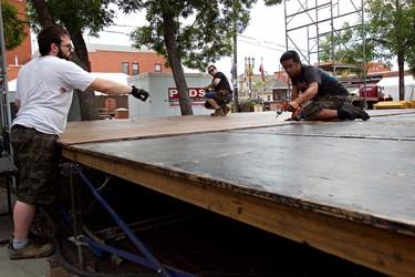 A crew dismantles the stage in Gazebo Park following the Edmonton Fringe Festival in Edmonton on Monday, August 22, 2011. CODIE MCLACHLAN/EDMONTON SUN QMI AGENCY