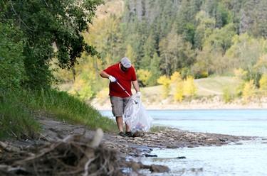 Jay Joncas picks up garbage along the North Saskatchewan River, near Emily Murphy Park, during the Edmonton portion of the Great Canadian Shoreline Cleanup, Saturday Sept. 17, 2011.  DAVID BLOOM EDMONTON SUN  QMI AGENCY