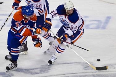 Team Blue's Ryan Nugent-Hopkins jostles with Team White's Ryan Smyth during the Edmonton Oilers' Joey Moss Cup pre-season game at Rexall Place in Edmonton on Sunday, September 18, 2011. CODIE MCLACHLAN/EDMONTON SUN QMI AGENCY