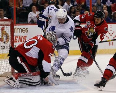 Ottawa Senators goalie Robin Lehner can't make a save against Toronto Maple Leafs' Nikolai Kulemin (41) as Senators' Mark Borowiecki (74) looks on during the second period of pre-season NHL action at Scotiabank Place on Tuesday night. (DARREN BROWN/QMI AGENCY)