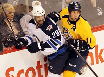 Winnipeg Jets Johnny Oduya (l) is checked by Nashville Predators David Legwand during NHL hockey play in Winnipeg Friday September 30, 2011. BRIAN DONOGH/WINNIPEG SUN/QMI AGENCY