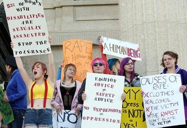 Women wave placards during the Slut Walk in Winnipeg Saturday October 15, 2011. BRIAN DONOGH/WINNIPEG SUN/QMI AGENCY