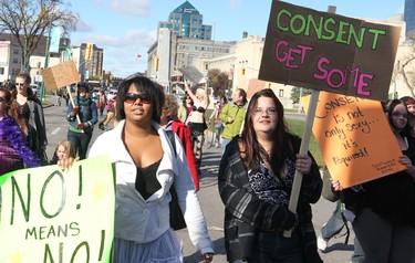 Demonstrators carry placards during the Slut Walk in Winnipeg Saturday October 15, 2011. BRIAN DONOGH/WINNIPEG SUN/QMI AGENCY