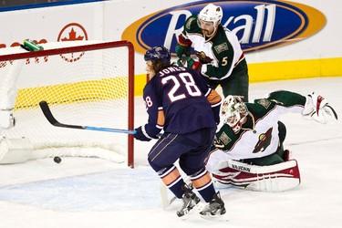 Edmonton's Ryan Jones scores on Minnesota's Niklas Backstrom during the Edmonton Oilers NHL hockey game against the Minnesota Wild at Rexall Place in Edmonton on Friday, October 20, 2011. CODIE MCLACHLAN/EDMONTON SUN QMI AGENCY ***NOT FOR RESALE***
