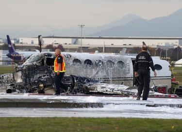 B.C. Paramedics survey the scene where a small plane crashed near Vancouver International Airport in Richmond, B.C., October, 27, 2011. (Richard Lam/QMI Agency)