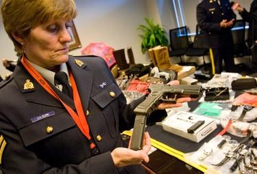RCMP Cpl. Cathie Glenn shows an air pistlol with the Glock name on it. (DAVE THOMAS/Toronto Sun)