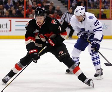 _BOT0170 - October 30, 2011  - Ottawa Senators' David Rundblad (7) stick handles past Toronto Maple Leafs' David Steckel (20) during the first period of NHL hockey at Scotiabank Place in Ottawa Sunday, October 30, 2011.  (DARREN BROWN/QMI AGENCY)