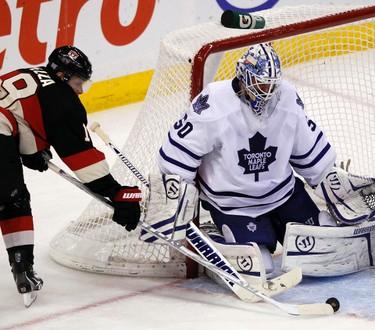 10302011_sensleafs0430 - October 30, 2011  - Ottawa Senators' Jason Spezza (19) tries to beat Toronto Maple Leafs' goalie, Jonas Gustavsson (50) during the second period of NHL hockey at Scotiabank Place in Ottawa Sunday, October 30, 2011.  (DARREN BROWN/QMI AGENCY)