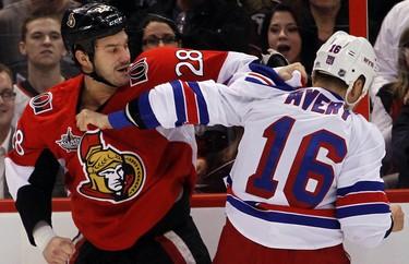 _BOT0064 - November 9, 2011  - Ottawa Senators' Zenon Knopka (28) fights New York Rangers' Sean Avery (16) during the first period of NHL hockey action at Scotiabank Place in Ottawa Wednesday, November 9, 2011. (DARREN BROWN/QMI AGENCY)