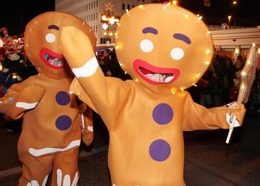 Gingerbread men march in the annual Santa Claus Parade Saturday. (BRIAN DONOGH/WINNIPEG SUN)