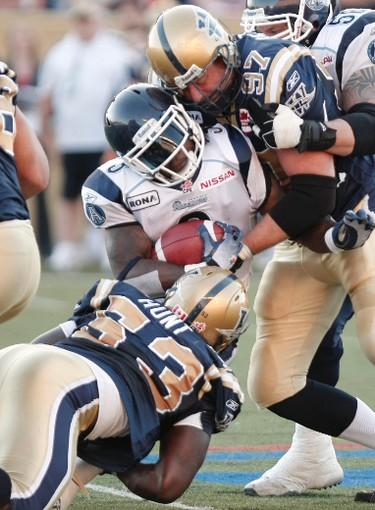 July 9/2010 - Winnipeg Blue Bombers player Phillip Hunt (53) and Doug Brown (97) crush Argonauts' player Cory Boyd during CFL action between the Toronto Argonauts and the Winnipeg Blue Bombers Friday, July 9, 2010. (MARCEL CRETAIN/Winnipeg Sun - QMI Agency)