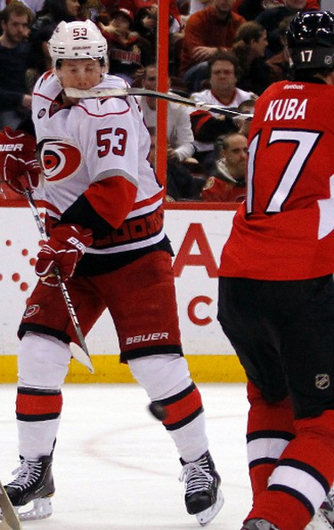 _BOT0097 - November 27, 2011  - Ottawa Senators' Filip Kuba (17) feeds Carolina Hurricanes' Jeff Skinner (53) his stick during the second period of NHL hockey action Sunday November 27, 2011. (DARREN BROWN/QMI AGENCY)