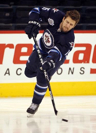 Winnipeg Jets left winger Tanner Glass fires a shot prior to playing the New Jersey Devils in NHL hockey in Winnipeg Saturday, December 03, 2011. BRIAN DONOGH/WINNIPEG SUN/QMI AGENCY