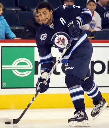 Winnipeg Jets defenceman Dustin Byfuglien  fires a shot prior to playing the New Jersey Devils in NHL hockey in Winnipeg Saturday, December 03, 2011. BRIAN DONOGH/WINNIPEG SUN/QMI AGENCY