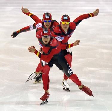 Team Germany with Alexej Baumgartner, Patrick Beckert and Marco Weber skates during the men's team pursuit at the Essent ISU speed skating World Cup in Heerenveen, December 4, 2011. (REUTERS/Michael Kooren)