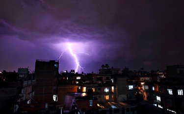 Lightning strikes during a thunderstorm in Kathmandu May 1, 2011. REUTERS/Navesh Chitrakar