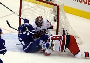 Leafs' Nikolai Kulemin gets taken down by Jaroslav Spacek into Cam Ward. MICHAEL PEAKE/TORONTO SUN/QMI AGENCY