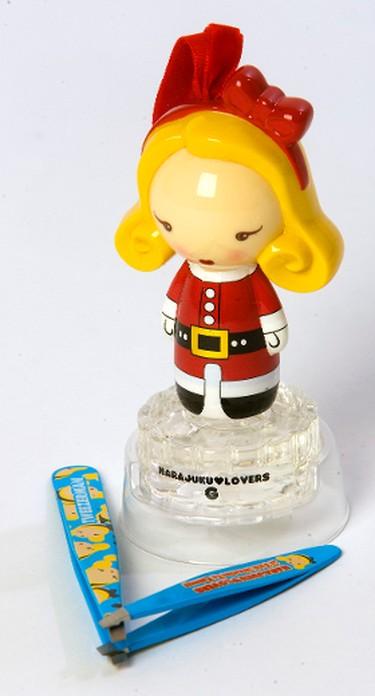 "Harajuku Lovers ""Jingle J"" holiday ornament, fragrance and large and mini slant tweezers. (10ml, $19.99, Shoppers Drug Mart, large tweezers, $30, mini $18, Sephora). (Mike Hensen/QMI AGENCY)"