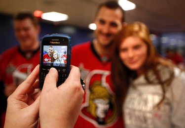 Sens_CHEO5 - December 21, 2011  - Ottawa Senators' Nick Foligno (71) poses with Kylie Davidson during a visit to the Children's Hospital of Eastern Ontario Wednesday, December 21, 2011.  (DARREN BROWN/QMI AGENCY)