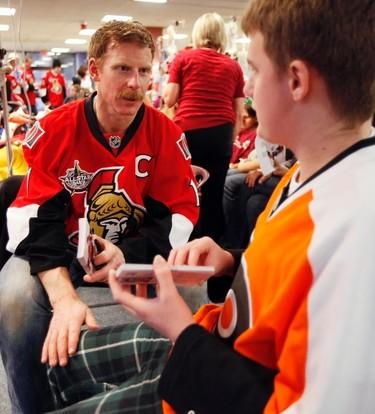 Sens_CHEO2 - December 21, 2011  - Ottawa Senators' captain, Daniel Alfredsson (11) speaks with Nicholas Monahan during a visit to the Children's Hospital of Eastern Ontario Wednesday, December 21, 2011.  (DARREN BROWN/QMI AGENCY)