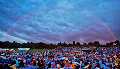A rainbow appears over fans at the Edmonton Folk Music Festival on Saturday, August 6, 2011. CODIE MCLACHLAN/QMI AGENCY