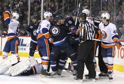 Winnipeg Jets LW Evander Kane reacts after slamming into New York Islanders goaltender Al Montoya during National Hockey League action at the MTS Centre on Tues., Dec. 20, 2011. JASON HALSTEAD/WINNIPEG SUN QMI AGENCY