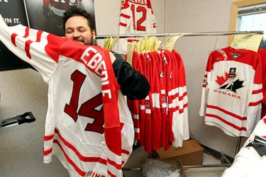 Tony Lopez makes Team Canada jerseys at the Nike Pressure is Power retail trailer, prior to the start of the Team Canada vs Denmark World Juniors hockey game in Edmonton Alberta, Thursday Dec. 29, 2011. Lopez estimates that he makes more than 100 jerseys a day. DAVID BLOOM EDMONTON SUN  QMI AGENCY