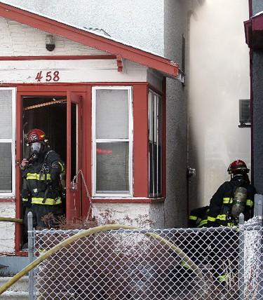 Winnipeg firegighters battle a house fire at 458 Magnus Avenue Friday December 30, 2011. BRIAN DONOGH/WINNIPEG SUN/QMI AGENCY