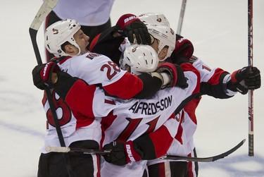 The Senators celebrate Daniel Alfredsson's winning shootout goal against the Canadiens at the Bell Centre in Montreal, Saturday, Jan. 14. (PIERRE-PAUL POULIN/QMI Agency)