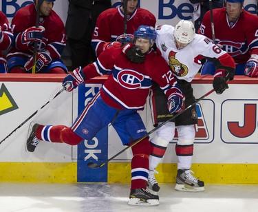Canadiens Erik Cole and Senators Erik Karlsson collide at the Bell Centre in Montreal, Saturday, Jan. 14. (PIERRE-PAUL POULIN/QMI Agency)