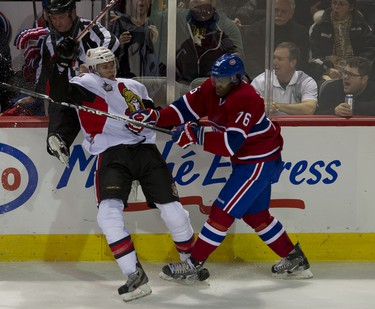 P.K. Subban checks Colin Greening The Senators take on the Canadiens in Montreal, January 14, 2012. PIERRE-PAUL POULIN/QMI AGENCY