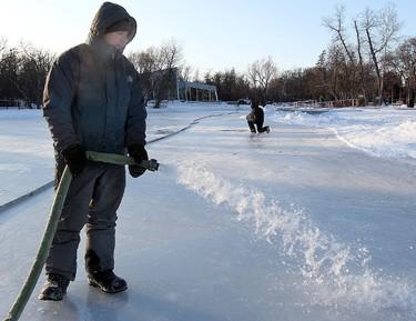 Assiniboine Park employee Bob Turcotte braves the cold to flood the duck pond in Winnipeg Thursday January 19, 2012. BRIAN DONOGH/WINNIPEG SUN/QMI AGENCY